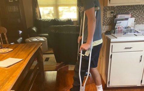 CRIP WALK: Sophomore Nick Stewart strolls around his house. Stewart is currently recovering in a rehab program.