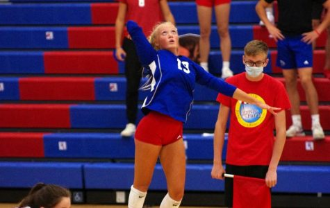 Heater: Emma Halter serves up a fastball against Martinsville. Halter led the team to a victory with seven aces.