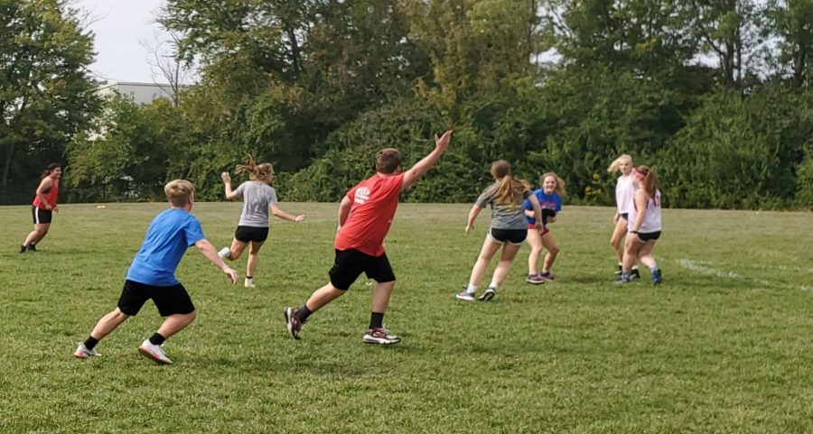FRISBEE+FANATICS%3A+Junior+Braeden+Cooper+beams+across+the+field%2C+hoping+to+receive+a+pass+from+senior+Lucy+Houser.+Ultimate+Frisbee+Club+was+the+first+club+to+meet+during+the+2020-2021+school+year.+In+order+to+comply+with+social+distancing+guidelines%2C+the+club+met+outside.