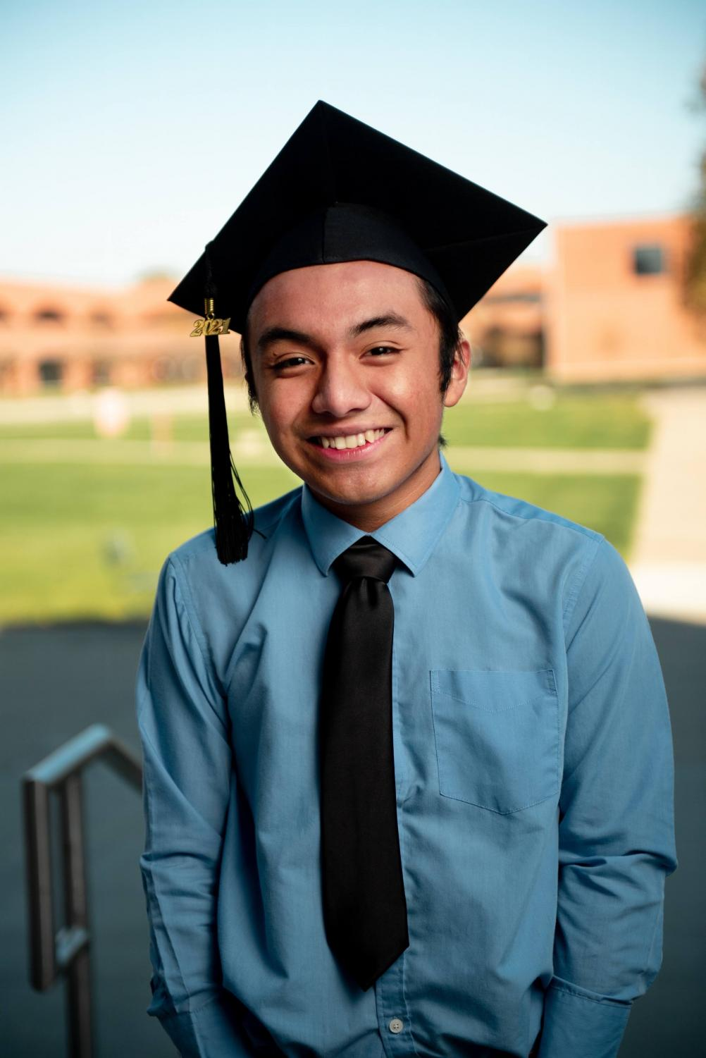 MATRICULATION EXULTATION: Senior Coby García shines a radiant grin for his senior photo. García plans to go on to study bioethics and public policy at Harvard.
