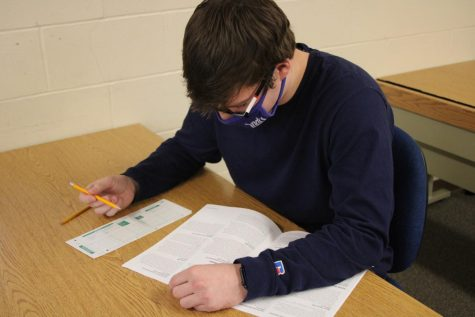 TESTING THE WATERS: Junior Sam Peeples prepares to take the SAT scheduled for May of 2021. Students can find more information on registration dates on the College Board website.