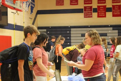 Science teacher Mrs Sarah Rose accepts canned food drive donations from students before school on Monday August 23.